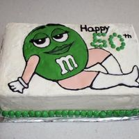 Green M&m Cake This is a yellow cake with almond buttercream. The M&M on the front was done color flow style with royal icing. I used an outline that...