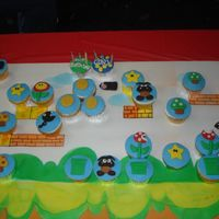Super Mario Brothers Cupcakes This was SO much fun to do! They are your basic yellow and chocolate cupcakes with vanilla buttercream frosting. The little creatures are...