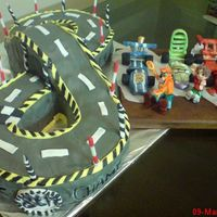 Figure8 Racing Track 8Th Bday Cake With Bridge & Stylised Go-Karts Driven By Video Game Characters & The Birthday Boy Figure8 racing track with faux bridge & stylised Go-Karts featuring 'Wingo' driven by 'Sonic the Hedgehog', '...