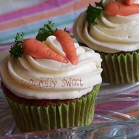 Carrot Cupcakes Carrots are fondant with parsley :)