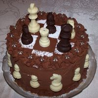 Chess Cake  Done as an emergency cake in my MIL's kitchen, with no equipment whatsoever (no spatulas, no turntable, no piping bag - nothing). Good...