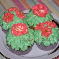 Flower Cupcakes   These were carrot cake cupcakes with classic cream cheese frosting (tinted green) and BC flowers.