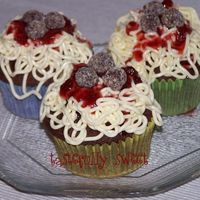 Spaghetti Cupcakes   Chocolate cupcakes with vanilla IMBC spaghetti, strawberry sause and chocolate truffle meatballs.