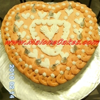 Staff Cake This is a 2 Layer Swiss Chocolate Cake from Scratch with Butter Cream basket Weave and added Chocolate Kisses on the top