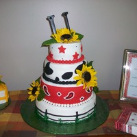 "Horse Lover's Birthday Cake  cake done in bc and fondant. cow spots in fondant, bandana in fondant with bc accents, fondant fence, artificial sunflowers, and ""..."