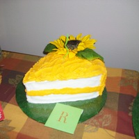 "Sunflower Slice Of Cake   cake done in bc icing. artificial sunflower. 2 ~8"" rounds carved."