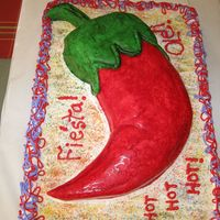 Chili Pepper This cake is a combo sheet cake with butter cream icing and a carved cake with fondant. I enjoyed making this cake for a birthday fiesta...