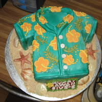 Aloha Shirt Birthday Cake Easy to shape into a shirt, I covered this cake in buttercream. I make the collar and stiched trim and added it to the shirt. I airbrushed...