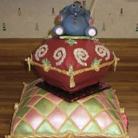 Nights In India Two stacked pillow cakes adorned with a fondant elephant on the top. Cakes are decorated with individually applied and painted sequins,...