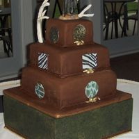 Hunters Groom Cake Three tiered covered in chocolate fondant with chocolate rope trim. Rope knot's painted in gold luster dust and sugar sheet cut out&#...