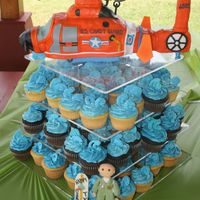 Hh-65 Coast Guard Helicopter Helicopter was completely edible. All fondant decor except blades which were gum paste, center was cake with nose and tail being RKT. My...