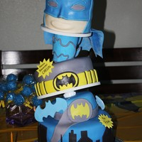 Batman!  Cape, Arm Cuff and Boomarangs were gumpaste, the rest was fondant :) This was for my little guys 4th Birthday! Plus some cake pops in the...