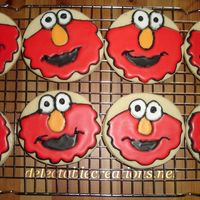 Elmo Cookies   Sugar cookies with Royal icing. First attempt at character cookies.