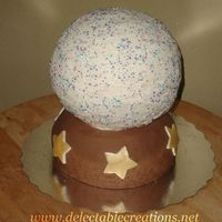 Crystal Ball   Fondant bottom, buttercream sports ball on top. Cake is banana with chocolate ganache.