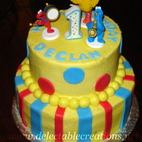 Sesame Street 2 Tier   Buttercream and fondant details. Figurines are plastic and store-bought.