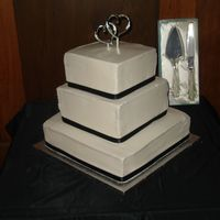 Wedding Cake - Black Ribbon   My 2nd attempt at a wedding cake...not my best work! And the biggest cake I've made.