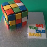 Rubik's Cube   My daughter's first attempt at cake decorating. She made this for her aunt's (my sister) birthday.