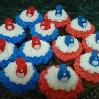 Red, White And Blue Cupcakes !!! Red White and Blue cupcakes with buttercream icing used star tip, fondant birds !!!
