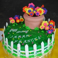 "Garden Party For my little girl's second birthday... a garden party.This was a 15"" round cake with a 3 layered 6"" round on top. Fondant..."