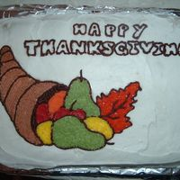 My First Thanksgiving Cake Yummy Pumpkin Spice cake. I transferred the outlines on the cake with piping gel as I learned in Wilton Course 1. :) Ran out of time for a...