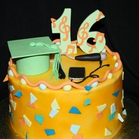 Graduation & Sweet 16 Double occasion. Graduation hat with ipod. Sweet 16 with music and microphone. Buttercream with fondant sugar art.