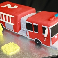 Firetruck Choc cake. 11x15 pan cut & carved. 12 hours start to finish including board to elevate the truck so that only the wheels touch base....