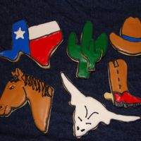 Texas Cookies March is Texas month and I made these for the teachers who had March birthdays. I put them in a terra cotta pot with a raffia bow and took...