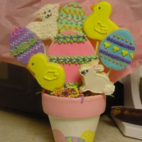 Easter Cookie Bouquet This is a sample of an Easter bouquet I will be selling as another fundraiser for my son. I handpainted the terra cotta pots.