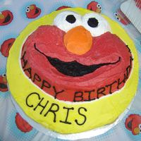 Elmo Baby's 1st Birthday. It was spanish style cake -moist and covered in BC. Tried to decorate Elmo differently !