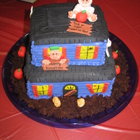 Haunted House Buttercream with fondant roof and accents.