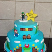 Mario Buttercream with fondant accents. The birthday boy likes Luigi the best so he is on the top of the cake.