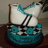 Break Skate Round cake with RCT skates. Fondant accent on Skates and Buttercream on cake sides with fondant top.