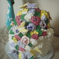 Basket Of Panies This cake is buttercream basket and royal icing butterflies and pansies. I used a ball pan to make the bump on top...next time I think I...