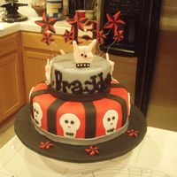 13Th Rocker Birthday This cake was for my friends son. He was turning 13 and having a Rock star theme. The cake is 2 tier with the top tier in chocolate and...