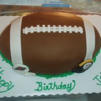 Superbowl...football Cake I made this cake for my cousins birthday party he was having on superbowl Sunday. I made the little helmets out of fondant and hand painted...