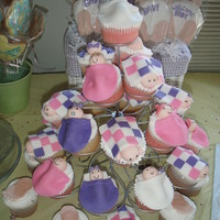 Tower Of Babies Cupcakes with fondant blankets and baby heads.