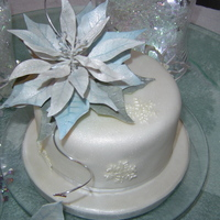 Poinsettia Christmas Cake  Large cake is rich fruit cake. Cup cakes are Red velvet with white choc mint butter cream and carrot cakes with cinnamon butter cream. Gum...