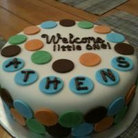 Dots White cake covered in fondant with fondant dots! Was made to match the plates!