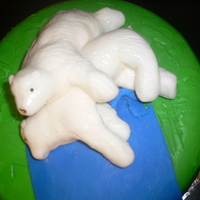 Mil's 50Th..sunbathing Polar Bears  German chocolate cake with chocolate buttercream filling, fondant polar bears... (don't ask she made herself an easy target for the...