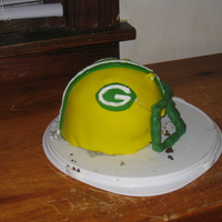 Packer Helmet Cake   Green Bay Packer helmet cake, my kids loved it but I think the proportions were off.