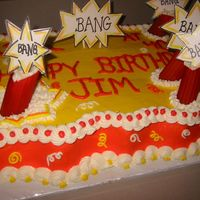 Life Is A Bang At 40! I created this cake from a pic that a customer gave to me. I made the dynamite sticks from tinted manicotti noodles, and they kept cracking...