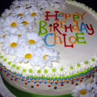 Daisy-Dot I designed this cake to match a friend's party decorations.