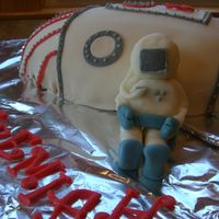 Space Rocket Ship Cake With Astronaut Made in a football pan, covered in fondant. I wished I had covered my board in something else. The foil really took away from the cake I...