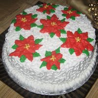 X-Mas Cake This was one of my first cake I made for x-mas. I learned the techniques seen on a toutorial. Yellow cake with strawbery filling. It was...