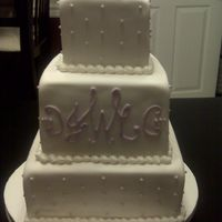 Purple Monogram Cake I apologize for the poor picture quality. This picture was taken with a camera phone.