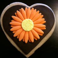 Gerber Daisy Cookie Peanut butter roll out cookie with chocolate fondant and MMF daisy. The customer gave me open reign on the design (all she cared about was...
