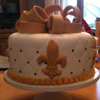 Saints Super Bowl Cake For my 2010 Super Bowl Party; Butter chocolate cake with MMF and buttercream.