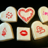 Valentine's Day - Stencil Cookies Using the stencils for Valentine's Day cookies! Did these in a lot of different color combinations. NFSC with MMF and Royal Icing...