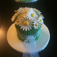 Bouquet Cake Cake is from scratch carrot cake with cream cheese filling and icing; flowers are gumpaste, stems are MMF.