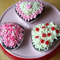 Valentine Mini-Cakes Double-chocolate cakes with buttercream frosting and candy toppers